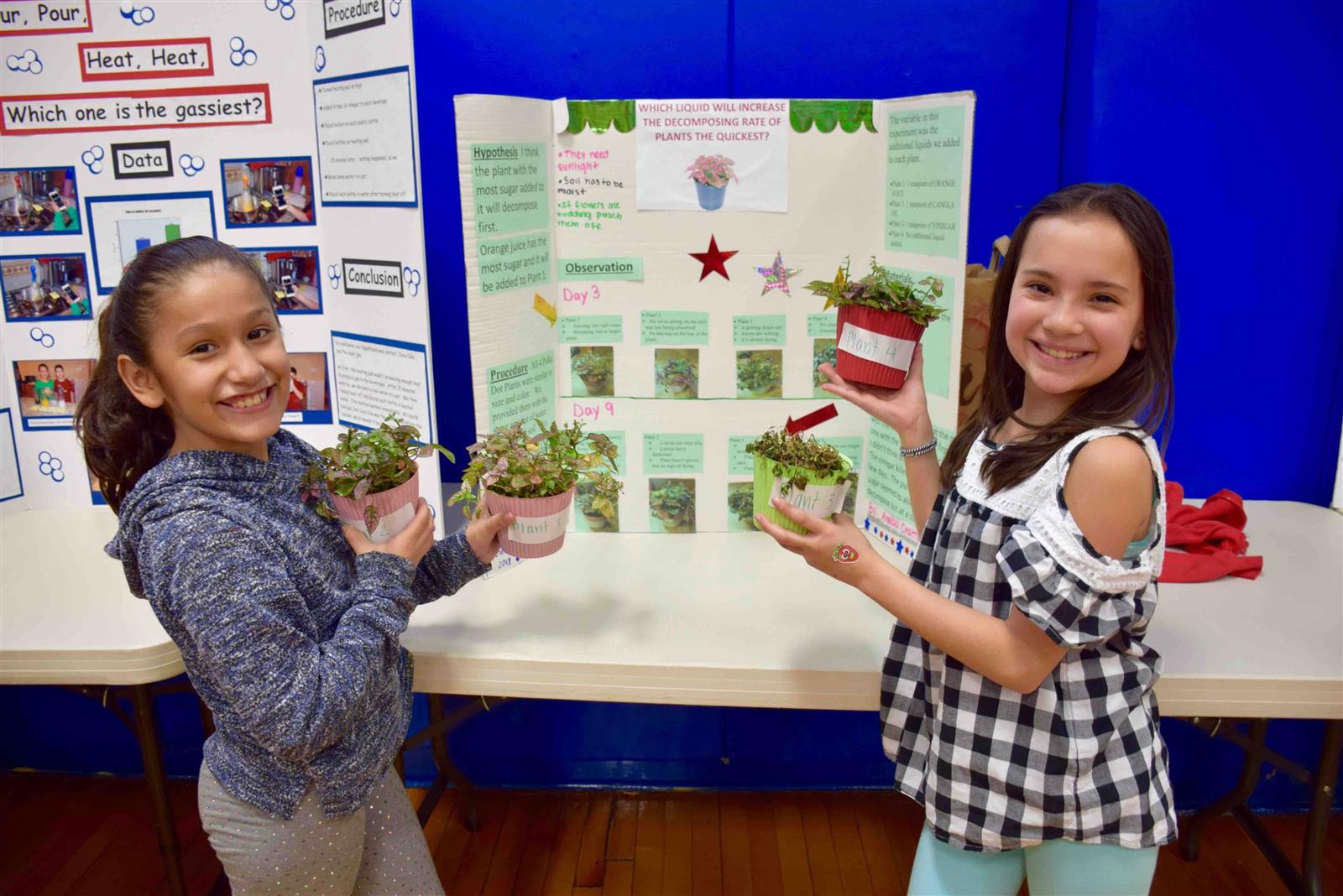 Photo of two students with plant project
