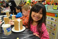 Kindergartners Build Gingerbread Homes for the Holidays Photo 3