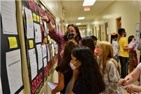 students viewing poetry on wall thumbnail183047