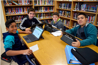 Photo of students learning databases