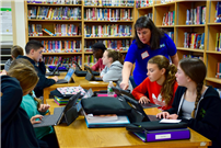 Photo of librarian helping students