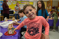 Kindergartners Build Gingerbread Homes for the Holidays Photo 2