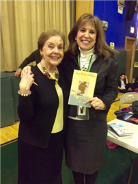 Photo of Principal Lucille McAssey and Holocaust Survivor