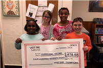 Photo of students with check to hurricane victims thumbnail85891