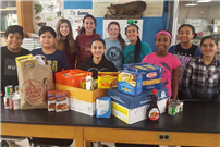Photo of North Middle School Students with Food Donations