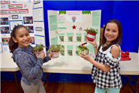 Photo of two students with plant project thumbnail89531