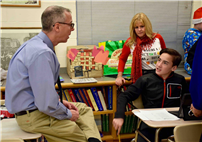 Photo of Mr. Farina speaking with student