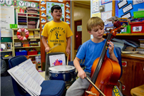 Photo of students playing music