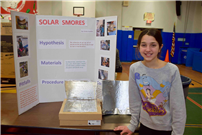Photo of student with smores project