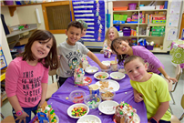 Students at Kindergarten Center Creating Gingerbread Houses